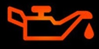 When this light is on, it is telling you that you have low or no engine oil pressure.  This light should be on when the ignition is on and the engine is off.  If this light is on while the engine is running, you could be low on engine oil, or you have a more serious problem.  Do NOT continue to run your engine with this light on or major engine damage could occur.